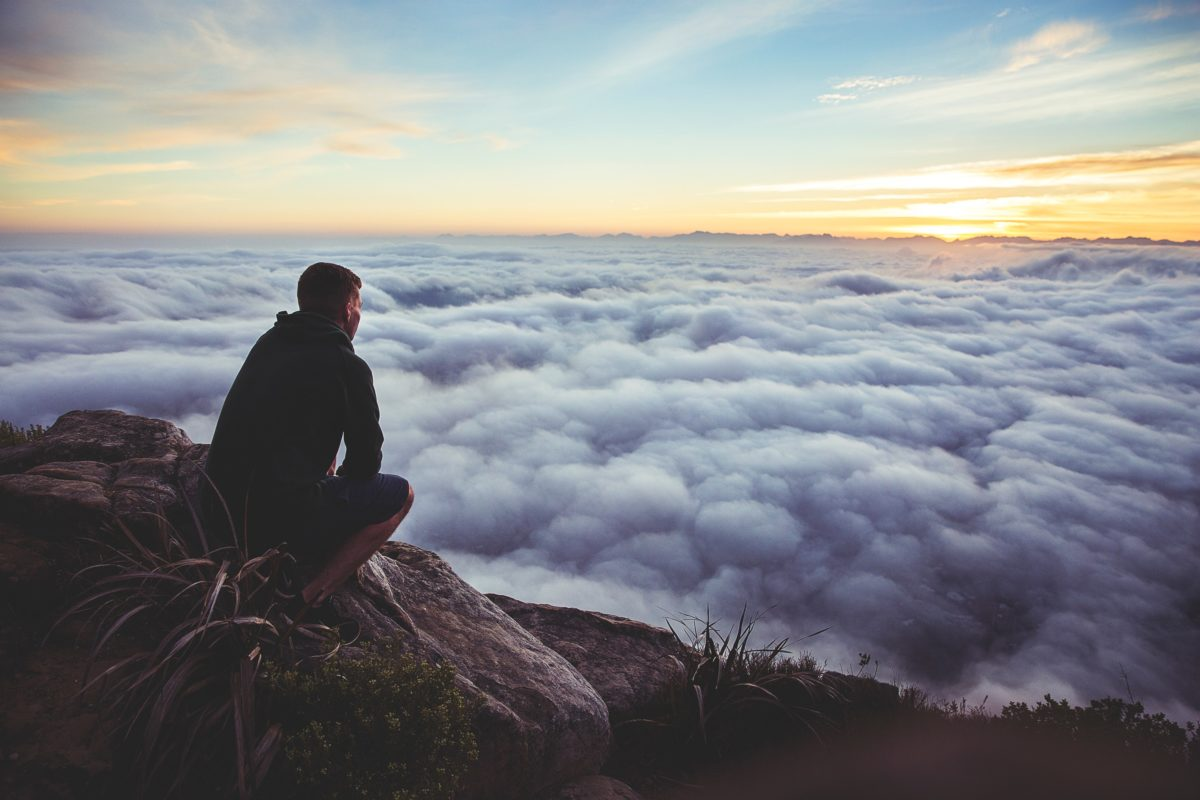 A man looking above the clouds