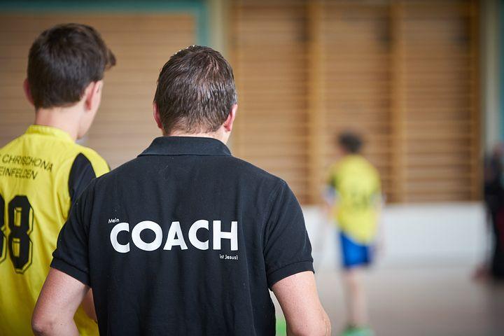 Coach wearing a black shirt