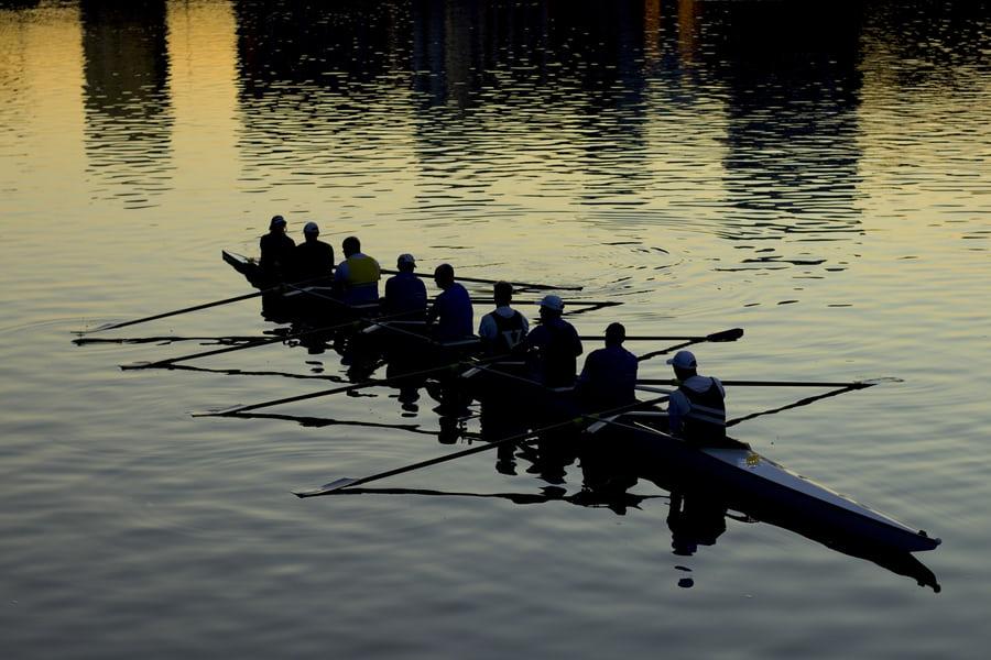 Team of men rowing